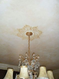CEILING/CHANDELIER IDEA: Don't like design but like the idea of accenting the chandelier with ceiling art.   <  http://paintit.typepad.com/painter_girl/page/21/  >.