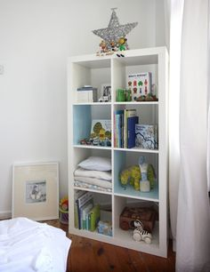 Ikea expedit shelving unit - definitely doing this in the nursery