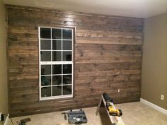 Originally I wanted a barn wood wall & my hubby was going to go to my family farm & get real barn wood. But then I thought about splinters & the time he'd have to take sanding each piece, so he came up with the idea to use knotty pine & stain it. I wanted it to look old & found some grey stain, which looked liked paint. So bless his heart, he stained it twice with two different colors to get the look I wanted.