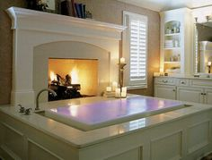 I would love to have a fireplace like that in the bathroom...and that bathtub...so amazing!