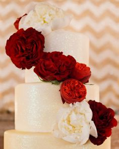 Glittering cake adorned with English cabbage roses (The roses would be good for a bouquet)
