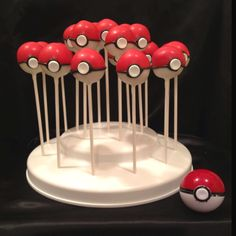 Pokeball cakepops for my sons bday. Pokeball toy used as example is in bottom right corner.