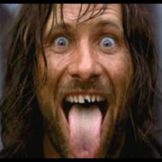 Viggo Mortensen showing off his chipped tooth the result of taking a sword to the face during the filming of the Battle of Helm's Deep (LOTR: The Two Towers) Aragorn, Arwen, Gandalf, Viggo Mortensen, The Middle, Middle Earth, Helms Deep, People Getting Married, The Two Towers