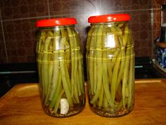 Pickled Green Beans Dilly Beans: 4 lbs green beans teaspoon crushed red pepper flakes, per jar teaspoon mustard seeds, per jar teaspoon dill seed, per jar 1 whole garlic clove, per jar 5 cups vinegar 5 cups water cup salt Pickled Green Beans, Spicy Pickled Beans, Pickled Corn, Pickled Beets, Pickled Onions, Bean Recipes, Healthy Recipes, Pickle Vodka, Canning Pickles