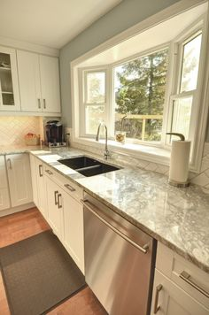 standard bay window with double sink- love the counter tops too!