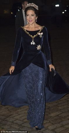 Crown Princess Mary of Denmark looked sensational in a midnight blue velvet and sequinned gown at the New Year banquet atAmalienborg Palace, Copenhagen on Friday