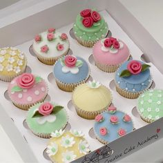 Pastel cupcakes with rose and flower designs.