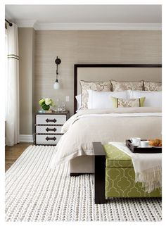 Textured wall with a matching king sized bed head board. Love the cable knit carpet as well.