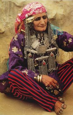 Africa | Portrait of an elderly Bedouin woman wearing traditional clothes and jewelry, Yemen | © Shelagh Weir #silver