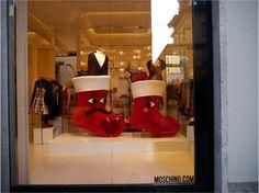 Regali nella calza. Chissà cosa nascondono queste calze dallo sguardo sbarazzino. (Negozio:  Moschino - Via della Spiga, Milano)