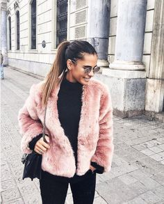 our babe @emitaz in blush + black wearing Lulus top, pants, and sunnies and the @somedayslovin the giver blush faux fur coat | link in bio to shop the look ☝️ #lovelulus #lulusambassador