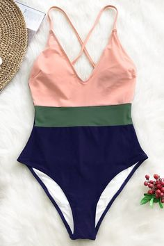 The pink, green and navy Color Block One-Piece Swimsuit exudes a sophisticated vibe. It has adjustable shoulder straps that crisscross at the back and a shelf bra with padded cups for additional support. Cute Swimsuits, Two Piece Swimsuits, One Piece Swimwear, Bikini Swimwear, Women Swimsuits, One Piece Swimsuit, Sporty Swimwear, Retro Swimwear, Outfit