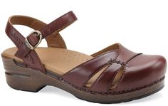 Dansko Maeve Brown:Open back, closed toe, this is the perfect transition shoe! High quality leather and rich hues pair equally well with Capris or jeans when the temps drop—which you'll love because they are so comfortable you'll never want to take them off!  $95.00