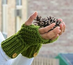 Crochet fingerless gloves like these are easy to make, giving you the option to add the wooden buttons for embellishment. These are great for the fall.