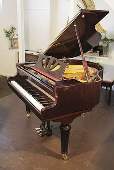 A Lothar Schell baby grand piano with a mahogany case, cut-out music desk and turned legsat Besbrode Pianos £3500. Piano has an eighty-eight note keyboard and a three-pedal lyre.