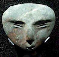 Mascaras para ofrendas que representan a los dioses Tlaloc, Quetzalcoatl, entre otros. Estas mascaras están hechas en piedra verde proveniente de la zona de Guerrero. (Cultura Azteca - Templo Mayor 1325d.c.)