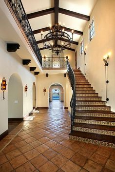 Beautiful Saltillo tile floor and tile stair risers. Wonderful ironwork on railings.