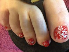 Pretty pedicure: Red polish with white hibiscus flowers, I love this!