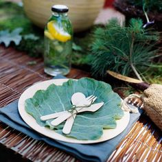 This earthy place setting is perfect for an outdoor party and can be put together in minutes. Set a single plate atop a solid-color place mat and add a large cabbage leaf to the center. Tie a bundle of flatware with green twine to finish the look.