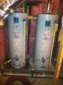 Two water heaters that are being replaced with a Tankless water heater. Before Picture.