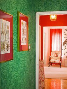 malachite wallpaper, coral or crimson accents, segue to a white and crimson room. delicious drama