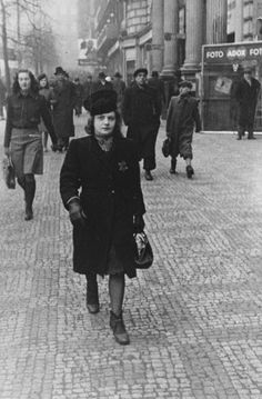 Elsa Eisne (the donor's aunt) walks down a street in Prague wearing the Jewish badge. Lest We Forget, Red Army, Twin Sisters, Christian Women, My People, Prague, Ww2, Faces, Husband