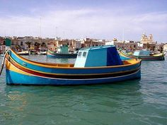 This is what Maltese call firilla.  She is a 100 year old carvel built traditional wooden boat. It was restored 40 years ago by our most master builder Giuzeppi Maniscalcolo, known as Tal- pittur.