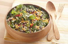 Light ranch plus hot pepper sauce adds a Tex-Mex flavor kick to a smart bean and corn salad with cheddar sprinkled on top.