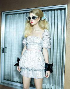 Taylor Swift....ummm....a little overboard? i don't like her like this, she looks like a barbie doll