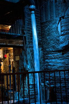 'Chelsea Market New York' Fine Art Photography by Evie Carrier - On a recent visit to New York City, I discovered Chelsea Market. This beautiful blue lighted waterfall next to the coffee house was an opportunity to get my camera out. Chelsea Market is in a restored historic factory, this festival marketplace hosts a variety of shopping and dining options, including bakeries, a fish market, wine store, and many others.