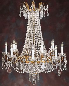 twelve lights Empire style crystal chandelier on an antiqued gilded hand wrought iron frame