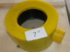 A yellow dismountable inflatable thread protector of 7 inch is on the table.