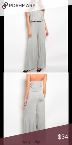 "🇺🇸 Women's strapless jumpsuit gray wide leg NWT Super STYLISH and comfy strapless jumpsuit features a blouson and pants have a wide leg.  Fabric Content 65% Rayon 35% Viscose.  Length: 52"" Bust: 12"" Width: 10"".  🇺🇸 All of my boutique clothing is made in the USA.  My promise to you is high quality stylish clothing at reasonable prices.  Buy with confidence I am a top rated seller, mentor and fast shipper.  Don't forget to bundle and save.  Thank you. Pants Jumpsuits & Rompers"