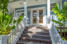 Love this porch and entry. The color too. Bright and welcoming.