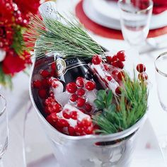 Your wine bucket just gained the spotlight on your dinner table. This trick will add a festive look to your Christmas decor! Freezing cranberries into your ice will make a fun and creative decorating piece at your table during the holiday season.