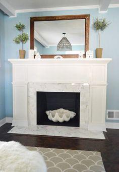 Young House Love | Our $200 Fireplace Makeover (Marble Tile and A New Mantel) | http://www.younghouselove.com