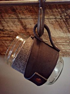 Leather and wool mason jar sleeve. https://www.etsy.com/listing/183747864/handmade-leather-mason-jar-sleeve