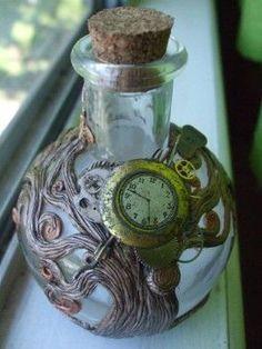 Steampunk Spirit Bottle.    Time on a bottle. Complete with antique gizmos, watch gears and metal bits. Ready to hold your most precious treasures.    All hand done by me. Sculpted out of polymer clay, baked and painted.