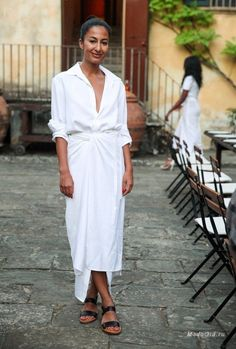 Completely chic white shirt and twist-front white maxi skirt with black sandals