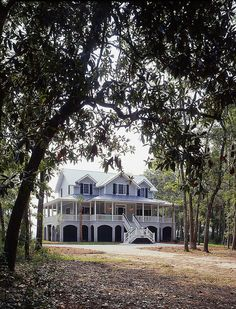 Edisto island, south carolina yankee barn home...I LOVE the wrap-around porch!