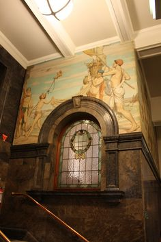 """Main stairwell, State Library of Victoria, Swanston Street.  Artist: M. Napier Waller, Section of """"Peace After Victory"""" , 1928"""