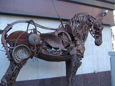 This unique bit of street art is a life-sized horse sculpture made from scrap metal and bits of old farm machinery. Just off Stephen Avenue, Calgary, Alberta. (Artist: Russell Zeid)