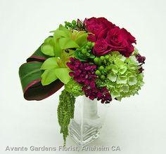 Lovely bouquet featuring Cymbidium orchids, roses, sweet william, hypericum, hydrangea, amaranthus