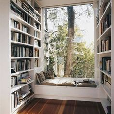 This sun-filled study equipped with enough books to last you through the winter.
