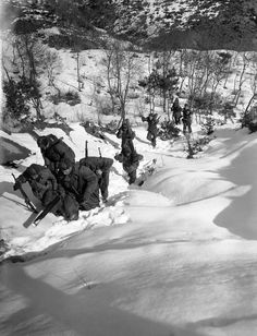 On War: Korean War 60th Anniversary A line of soldiers on a United Nations patrol mission plod through deep snow up a hill in the central front of Korea on Feb. 3, 1951