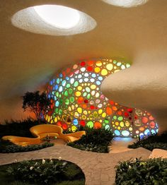 Nautilus House, which is so cool. A shell shaped house?  Sign me up!  But the best feature by far is this window. Gorgeous
