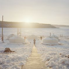 Celebrating Mongolia's Beautiful, Brutal Winter Cold | A man walks among the gers at a his camp in the early morning.  Chiara Goia  | WIRED.com