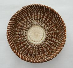 Love the rustic look of this small pine needle basket! Ivory Trinket Basket Ivory Coiled Pine Needle by CruisinCreations
