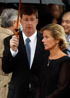 A steady rain pours down as Rep. Patrick Kennedy (D-RI) (l) and his sister Kara Kennedy watch their father Sen. Edward Kennedy's casket as it is loaded into the hearse.  Three generations of Kennedys gathered to mourn and pay tribute to the last prince of Camelot.