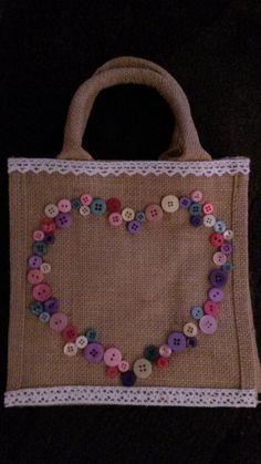 A button mini jute bag  (bellaroobags)
